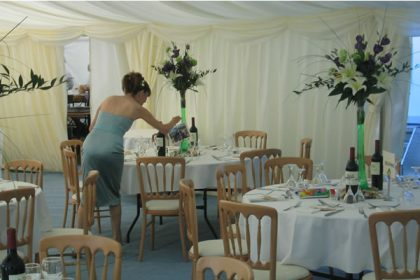 Classic wedding marquee with floral centre pieces
