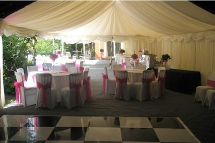 Opened sided 4.5m x 12m marquee for a summer wedding