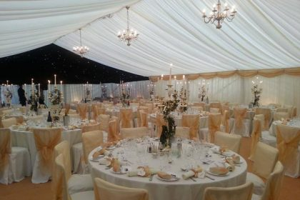 Gold themed wedding marquee in Weybridge, Surrey, 12m x 18m