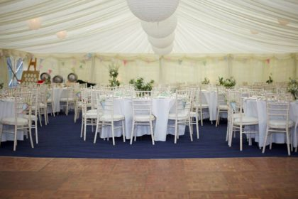 12mx27m wedding marquee with navy blue carpet and white paper lanterns