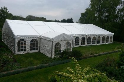 Great external shot of a 12mx21m marquee with a 3mx3m entrance marquee