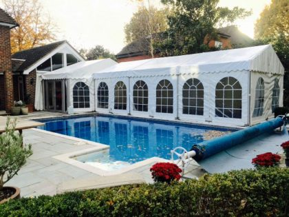 Lovely external shot of a poolside marquee for a Thanksgiving dinner