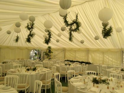 We installed hanging lanterns in white and grey and the customer added foliage hoops