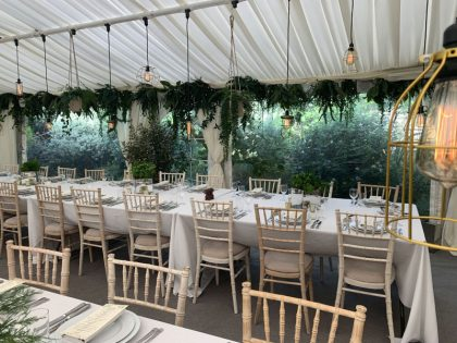 The use of foliage around the eave of the marquee creates spectacular results in this 9x18 marquee
