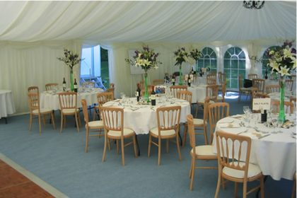 Simple, elegant wedding marquee with pale blue carpet