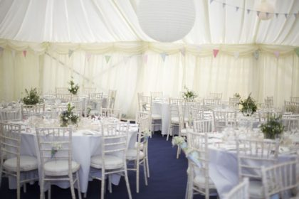 Different angle of the 12mx21m marquee with hanging lanterns