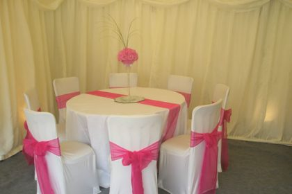 Banquet chair with cover and pink sashes