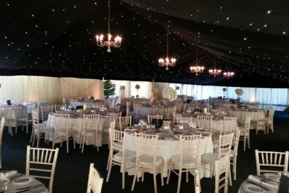 8-arm chandeliers are a great way to brighten up darker interior marquees
