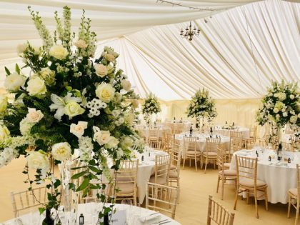 Tall flower centre pieces like this are really striking and practical too as your guests can still see each other!